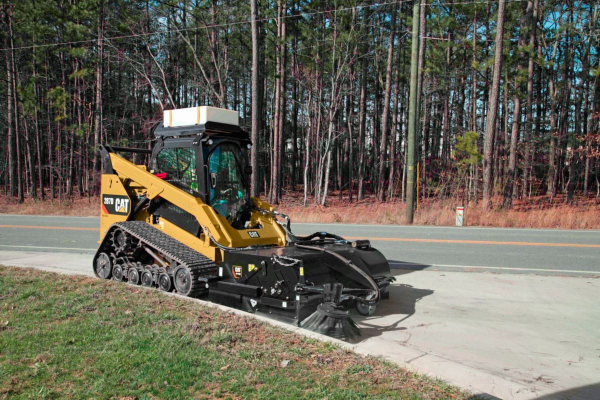 product-Cat® Pickup Broom at Work (shown with optional Dust Control Kit, Water Tank Kit and Gutter Brush)