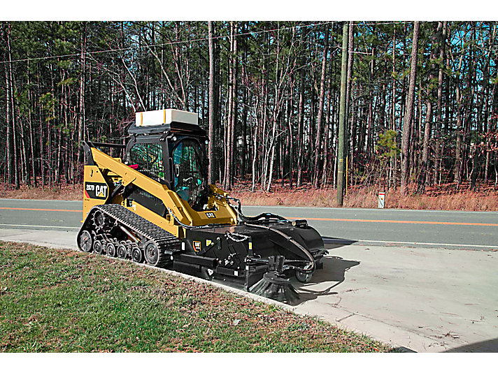 Cat® Pickup Broom at Work (shown with optional Dust Control Kit, Water Tank Kit and Gutter Brush)