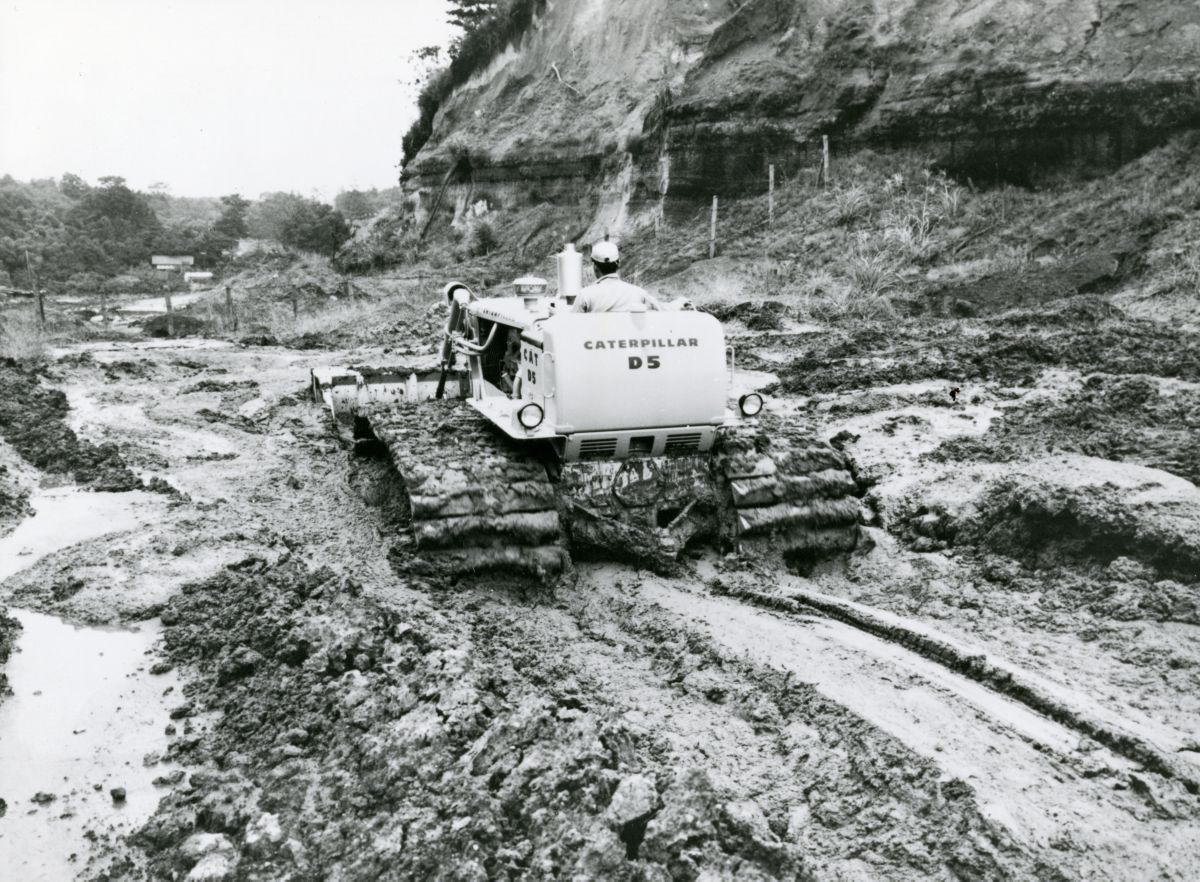 Cat© D5 track-type tractor working in the mud.