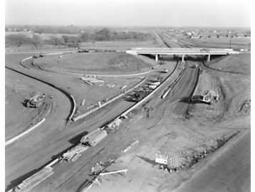 Contractors use Caterpillar machines to build the Federal Interstate Highway System, 1959.