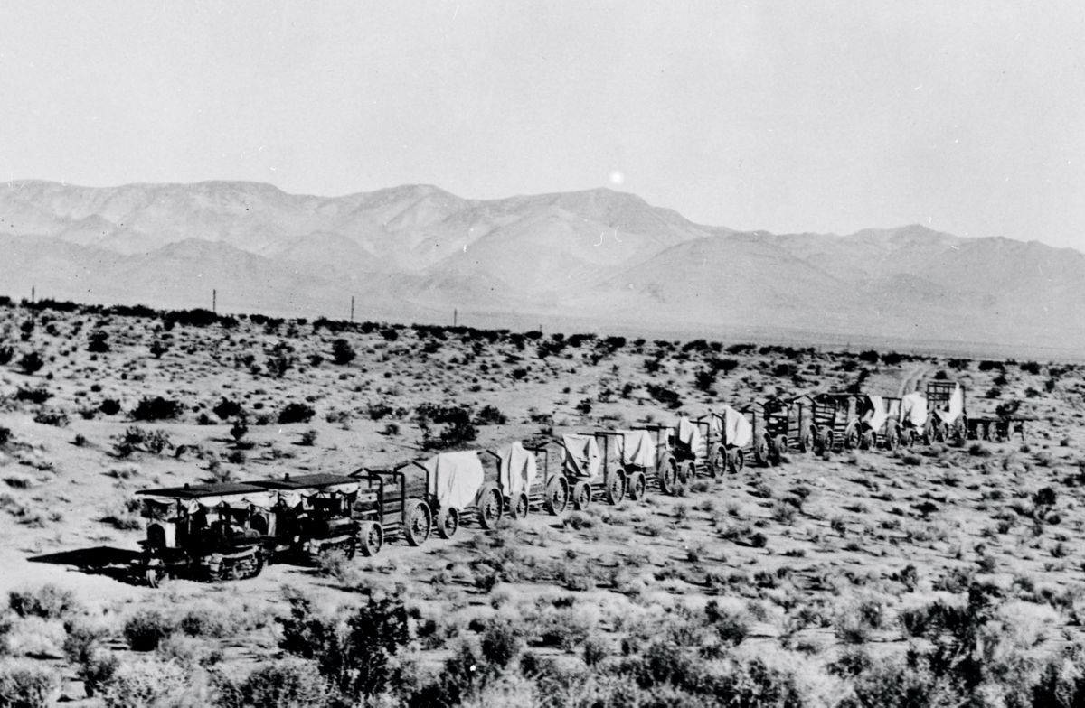 Holt Caterpillar gasoline powered track-type tractor pulling wagons during the construction of the Los Angeles Aqueduct.