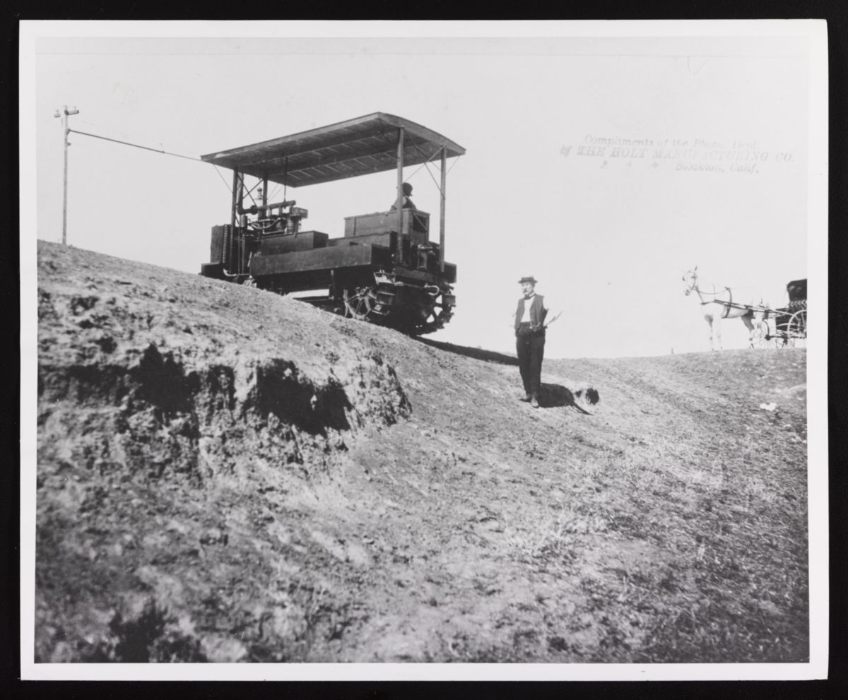 Benjamin Holt testing his gasoline powered prototype track-type tractor.