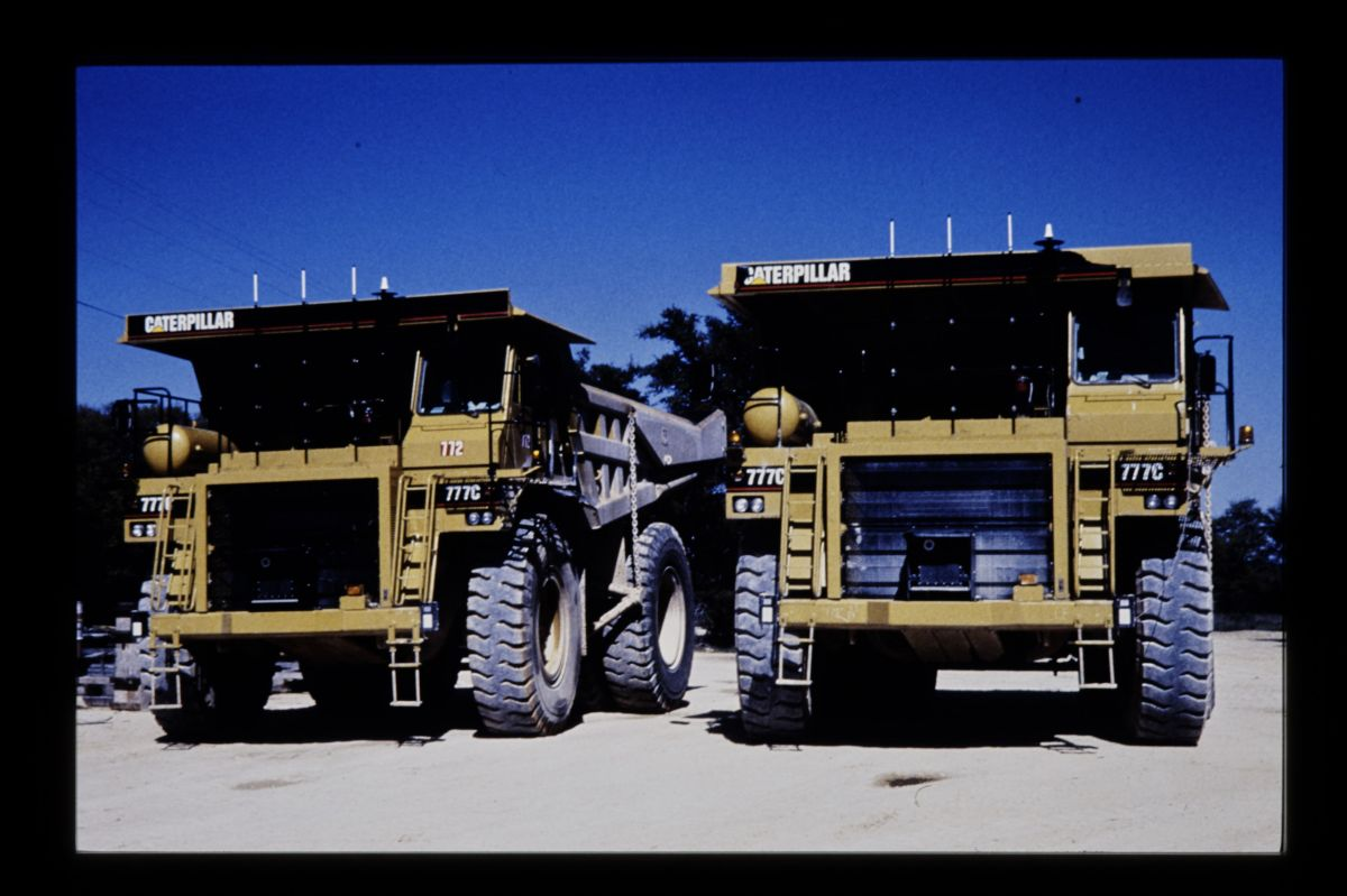 The first two prototype Cat 777C autonomous mining trucks at a Texas limestone quarry.