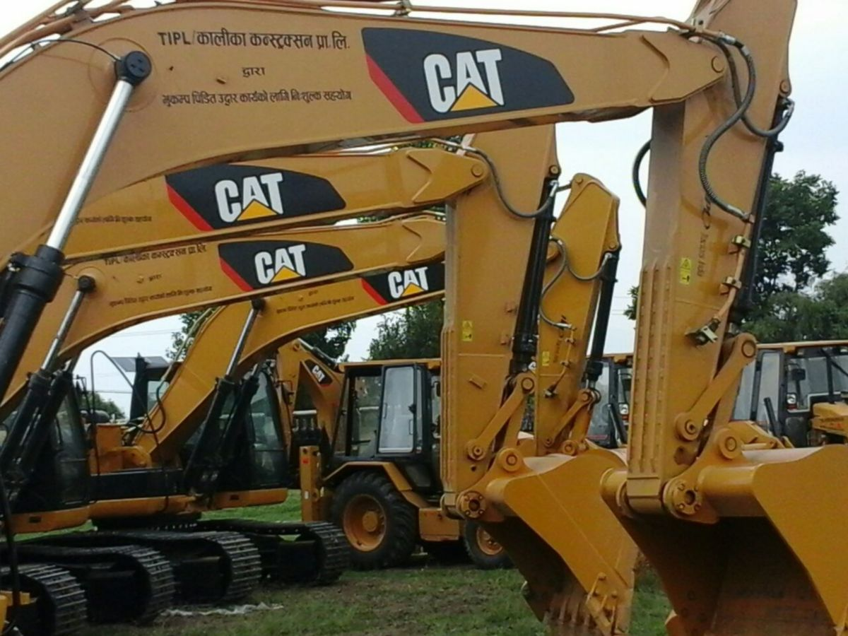 A fleet of Cat machines ready to work in Nepal after the 2015 earthquake.