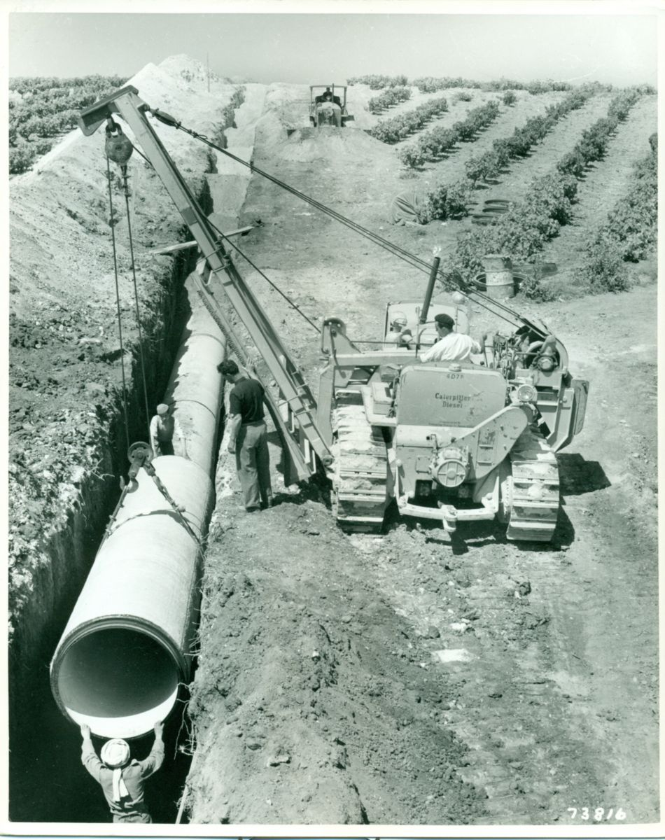 A Caterpillar D7 tractor with a pipelayer attachment in North Africa, 1950.