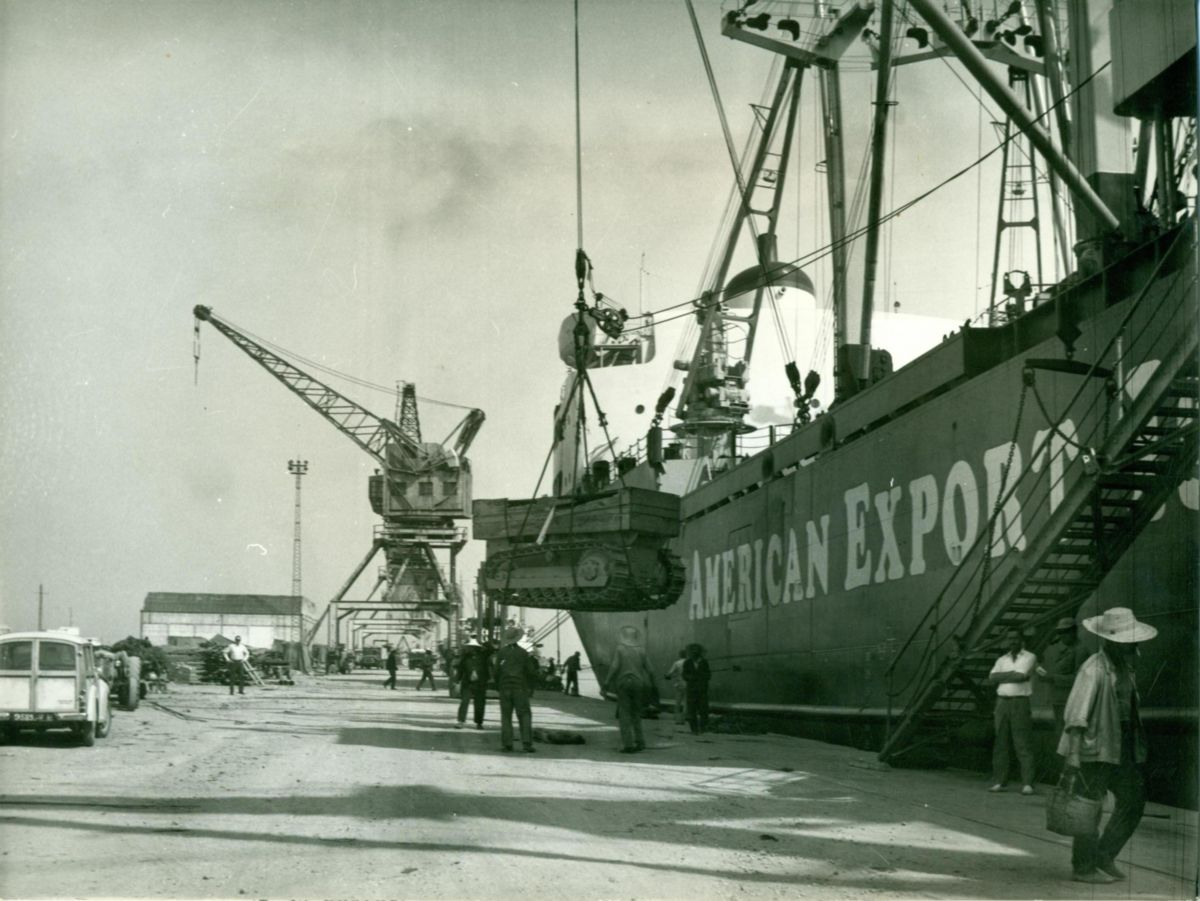 The first Caterpillar D4 tractor being unloaded at the port of La Goulette near Tunisia, 1938.