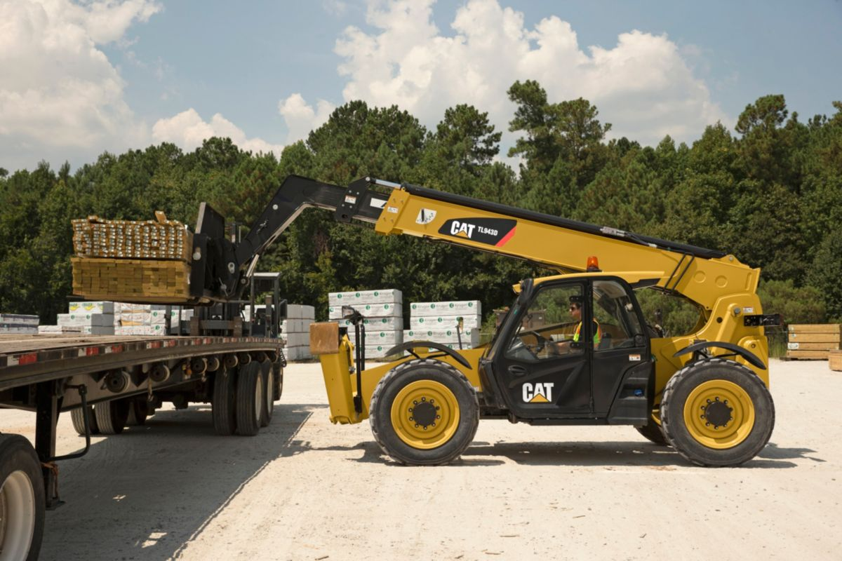 Small wheel loader with attachment