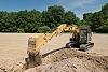313F Hydraulic Excavator emptying bucket