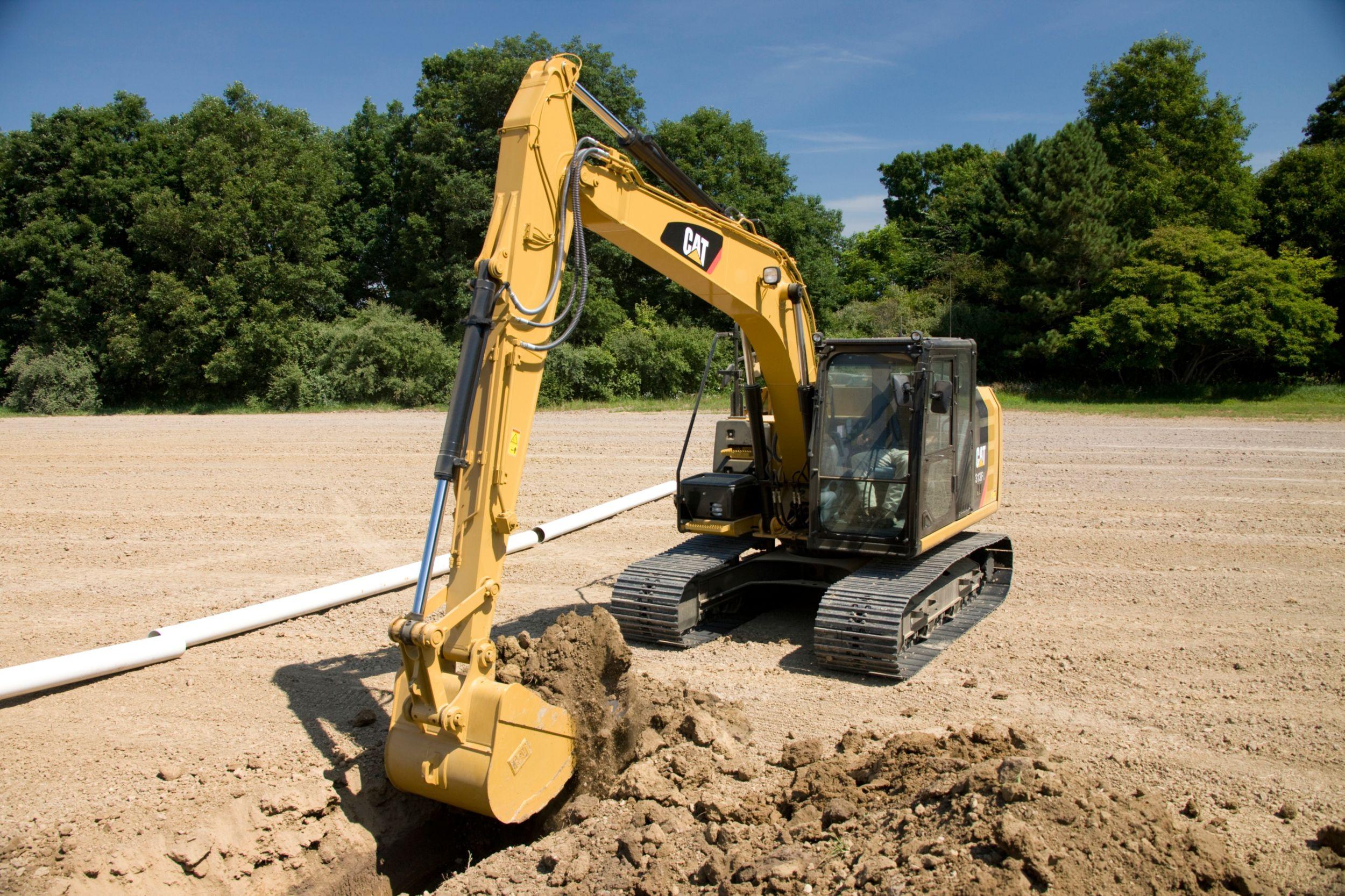 313F Hydraulic Excavator digging a trench>
