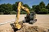 313F Hydraulic Excavator digging a trench
