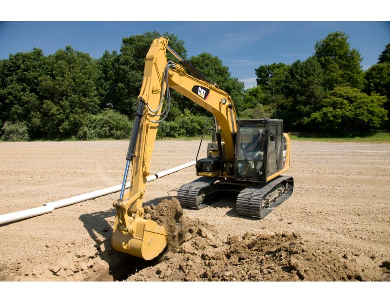 313F Hydraulic Excavator digging a trench