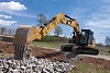 318F L Hydraulic Excavator emptying bucket full of rock