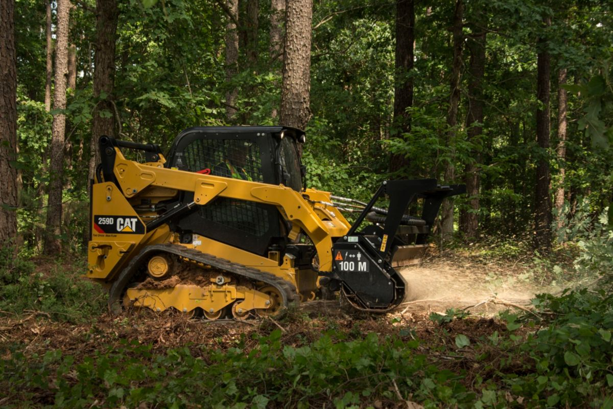 Cat® 259D Compact Track Loader and HM215C Mulcher>