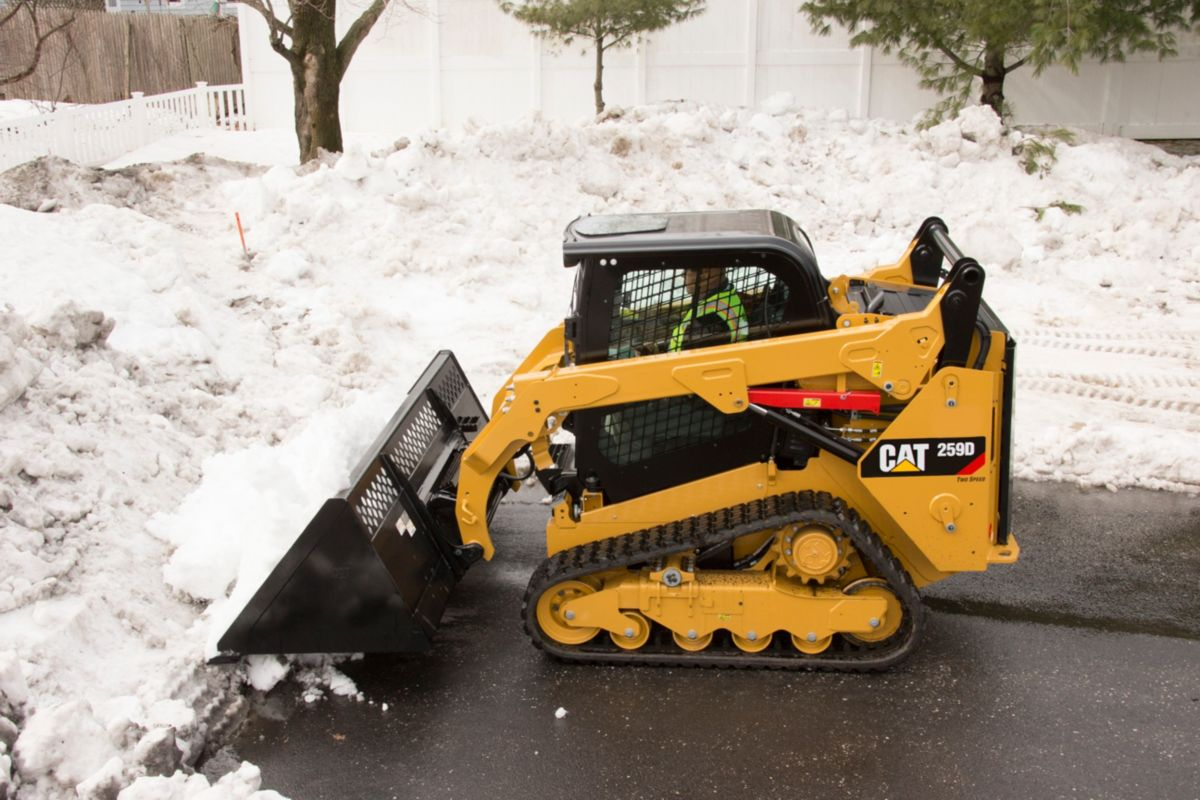 Skid Steer Loader Material Handling Bucket - Pushing Snow in New York>