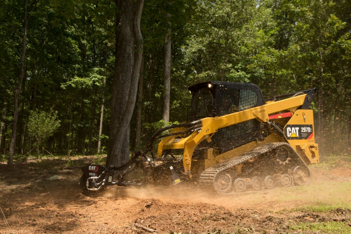 product-Cat® 297D2 and SG18B Stump Grinder at Work