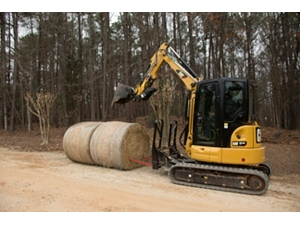 Cat® Bale Spear in use on a Cat 304.5E2