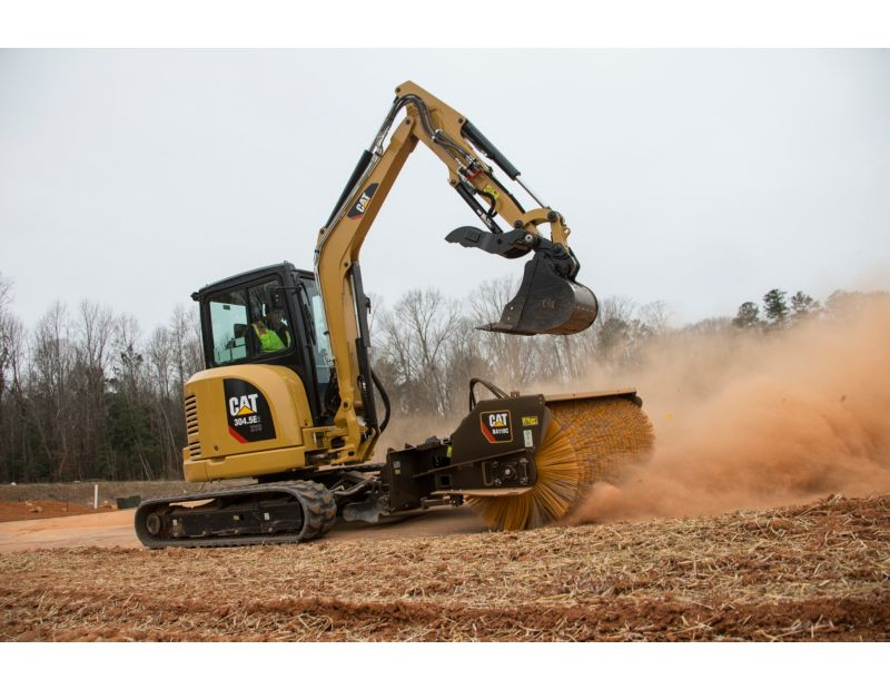 Cat® 304.5E2 XTC Mini Excavator sweeping with a BA118C Angle Broom