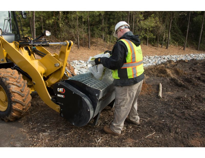 Customer Adding Mix to Cat® Mixing Bucket Using Integrated Bag Breakers