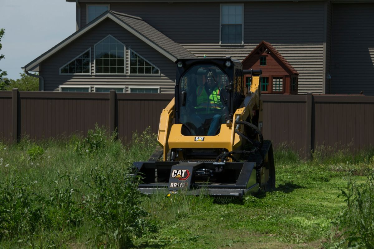 Cat® BR172 Brushcutter and 259D Compact Track Loader in a Landscaping Application