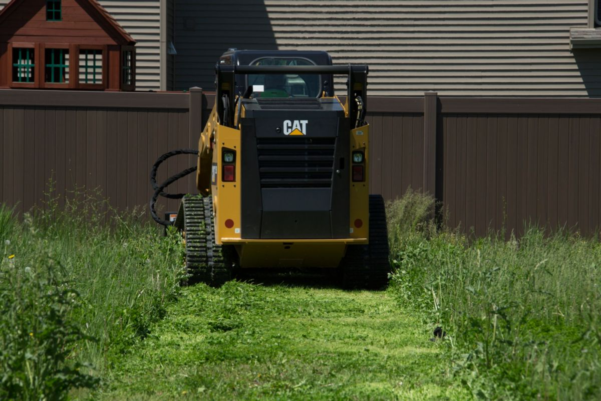 Cat® BR172 Brushcutter in a Landscaping Application>