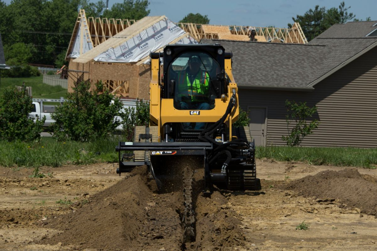 product-Cat® 259D Compact Track Loader and T9B Trencher Attachment Digging a Trench