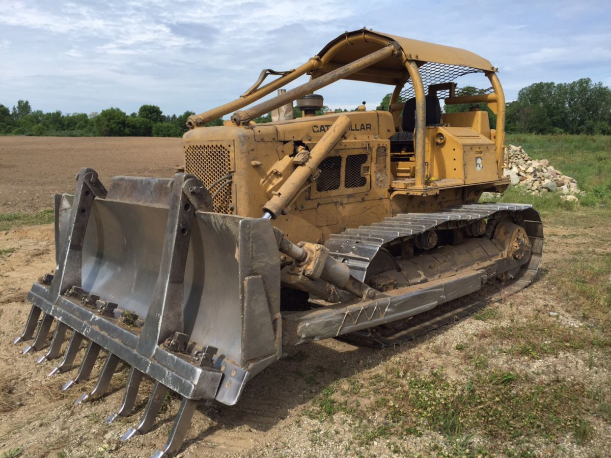 "... operating; Serving as the centerpiece of Henry Schinske's fleet is a  1981 Cat D5B Dozer with three; "" ..."