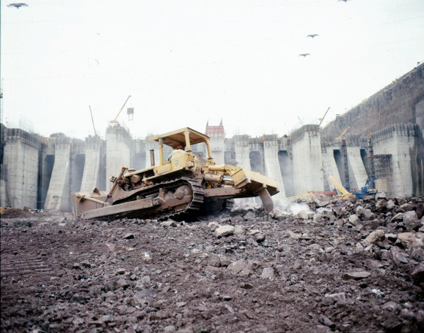 Cat dozer working on the site of the Itaipu dam, located on the border between Brazil and Paraguay. Built between 1971 and 1984, the dam set a world record for hydroelectric power production in 2016.