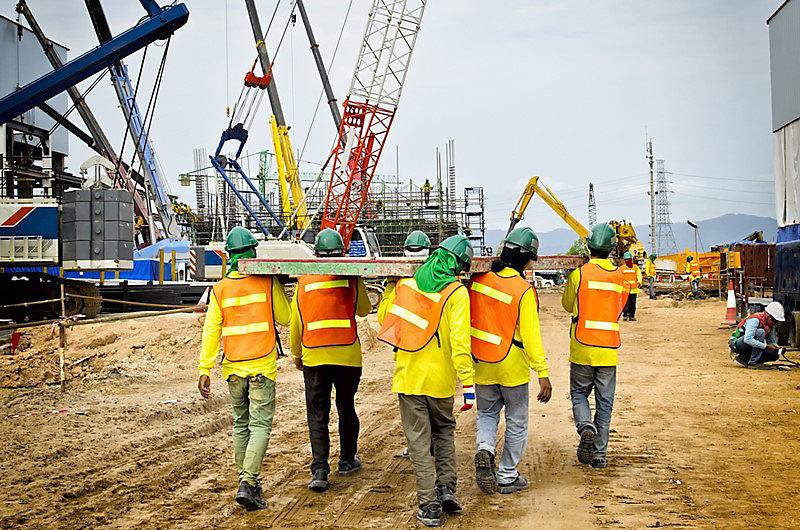 Men carrying materials on a jobsite