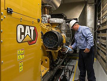 man working on generator
