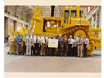 D10 development team with the first production model off the line.