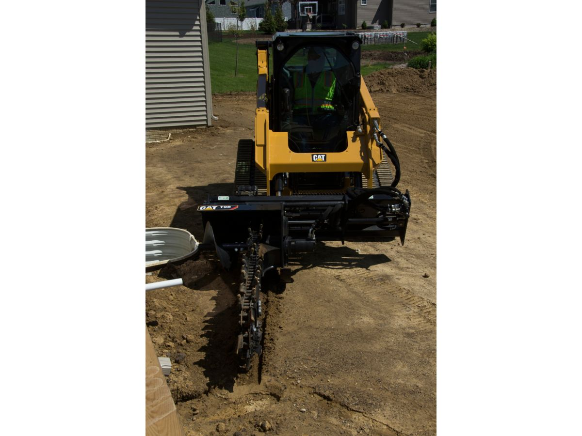 Hydraulic or manual sideshift provides close trenching flexibility near  structures or obstructions. Hydraulic sideshift, standard on the T15B  (optional on ...
