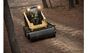 Cat® Vibratory Drum Compactor Smoothing a Path