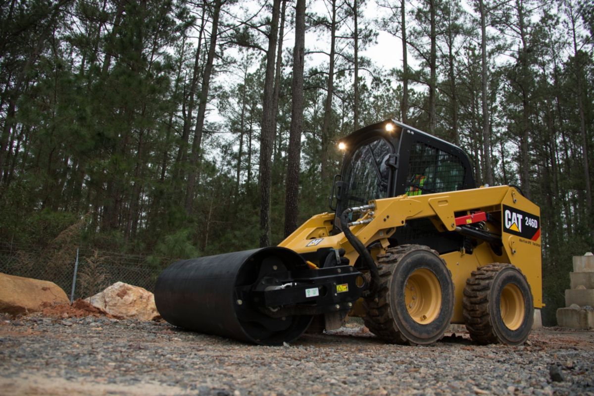 product-Cat® 246D Skid Steer Loader and Vibratory Drum Compactor at Work