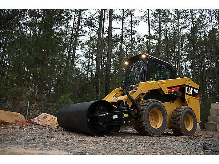 Cat® 246D Skid Steer Loader and Vibratory Drum Compactor at Work