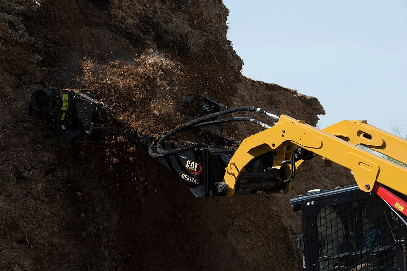 Cat® DFS124 Silage Defacer Reaching High in the Pile
