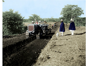 Haile Selassie, emperor of Ethiopia, inspects a construction site on the Jhimma road, the longest road in the nation. The project was completed by Caterpillar Thirty tractors and graders.