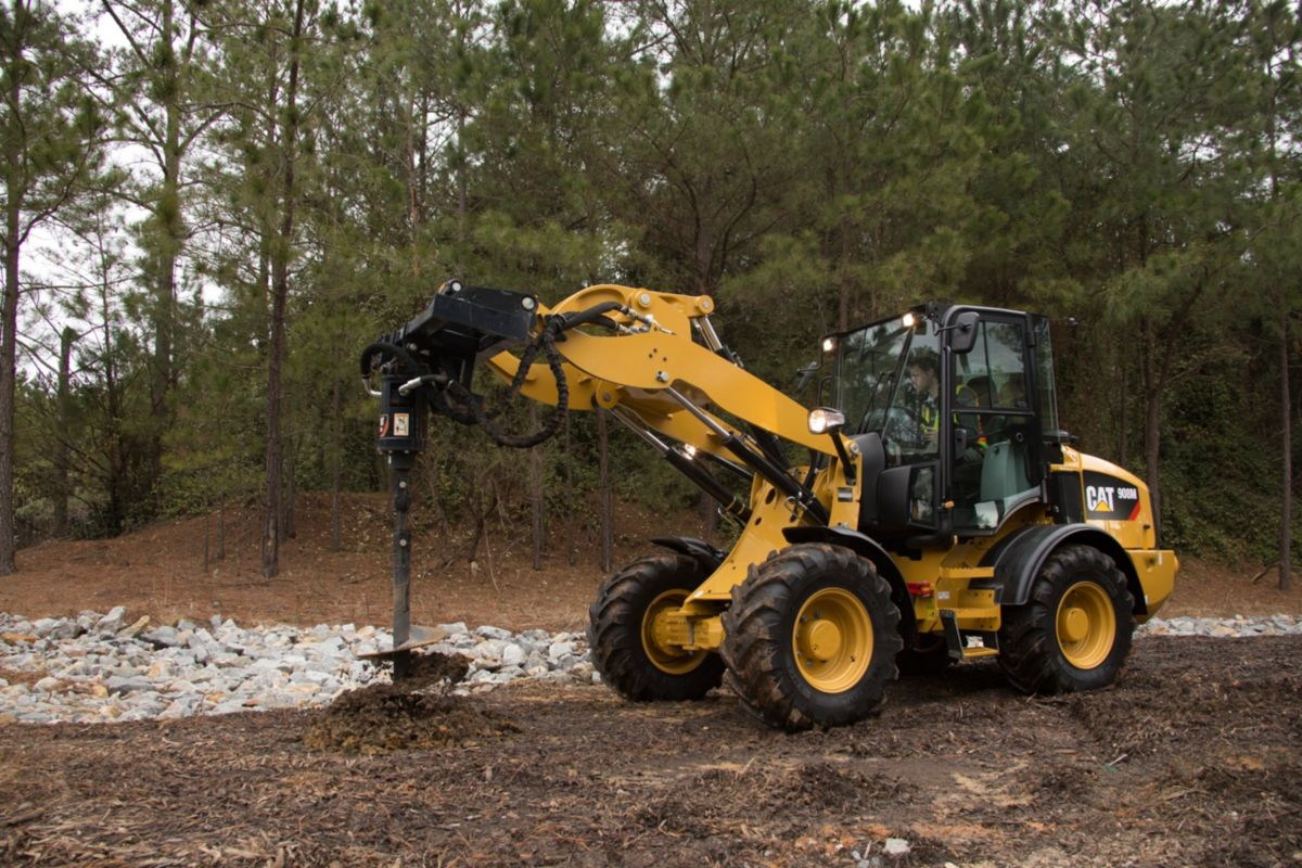 product-Cat® Auger at Work on a 908M Compact Wheel Loader