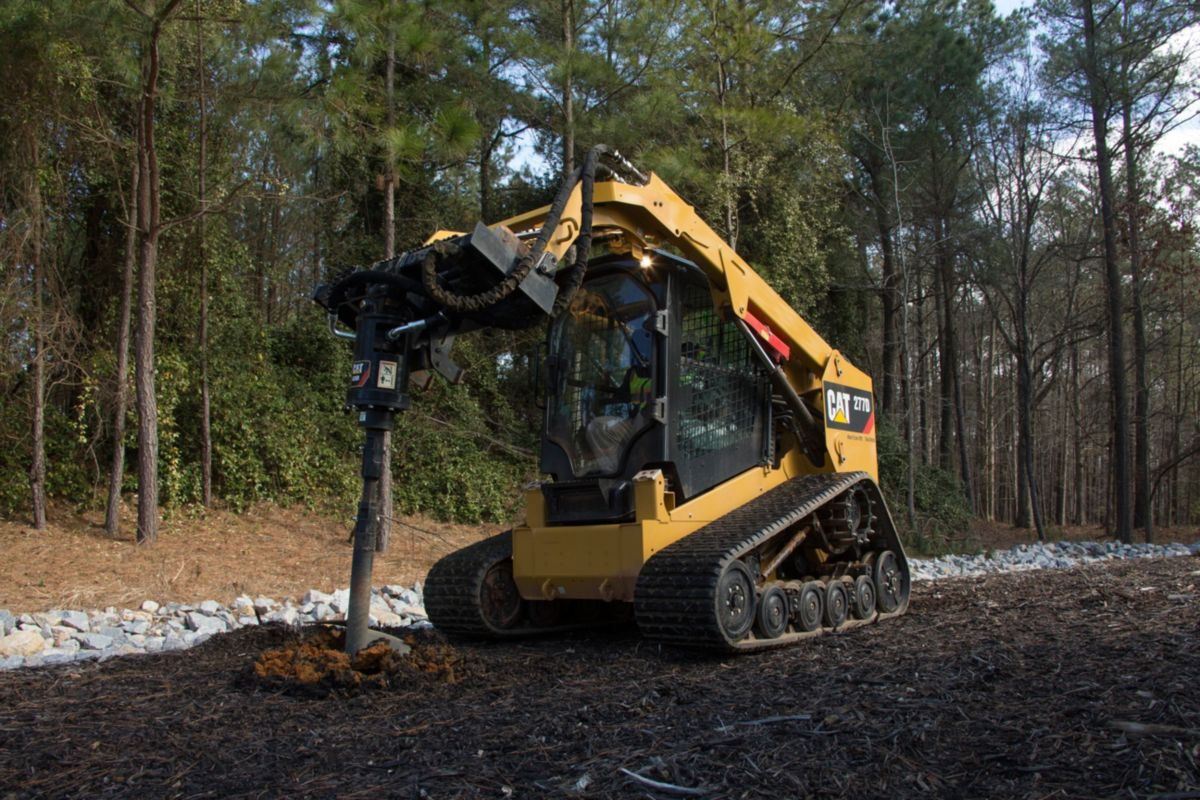 Cat® A26B Auger at Work on a 277D Multi Terrain Loader>