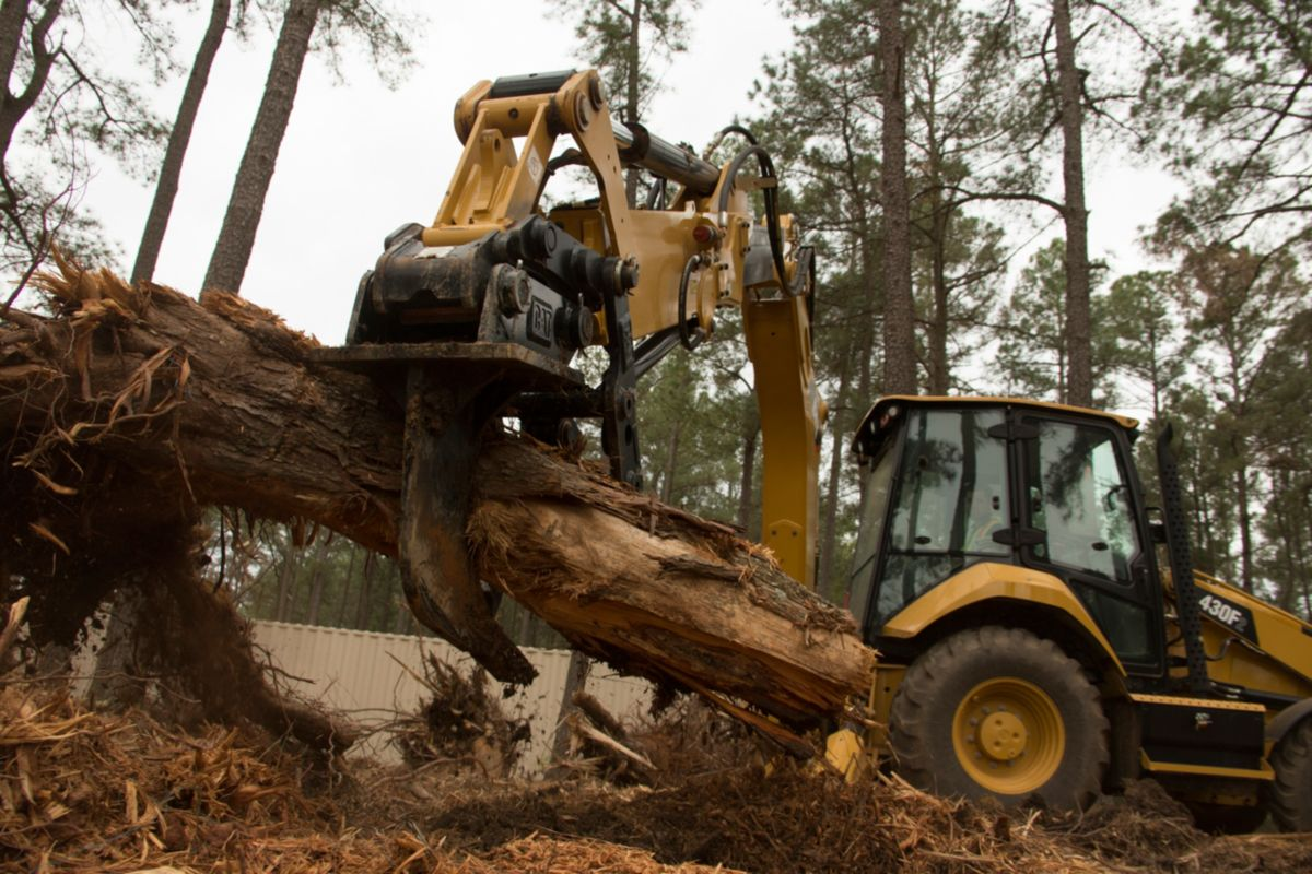 product-Cat® 420F2 Backhoe Loader with Thumb and Ripper in Working Application