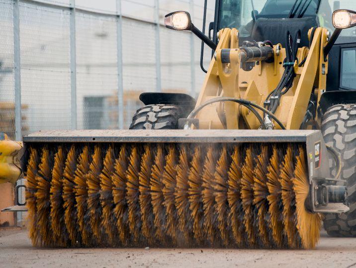 compact wheel loader brush attachment