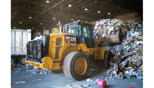 950M Waste Handler working hard in a recycling depot