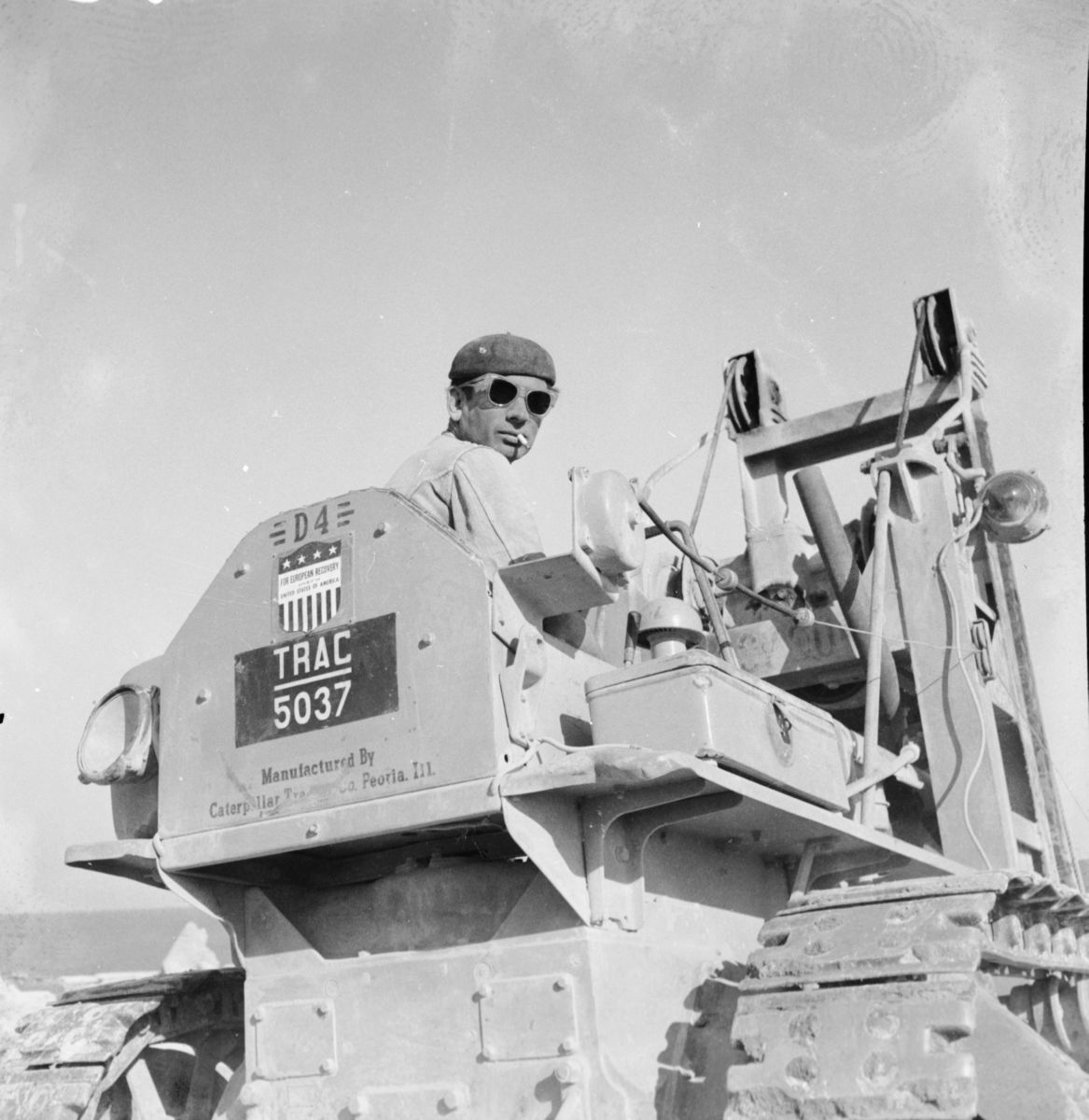Operator poses on his Cat® D4 during excavations.