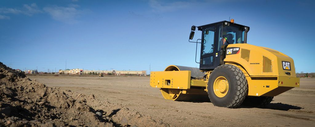 Cat® Vibratory Soil Compactor working on a job site.