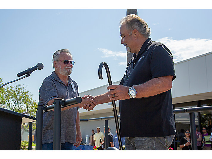 The Solar Cane tradition - Harry passing the cane to Gary.