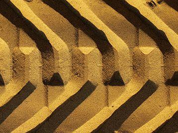 Machine tire tracks in the dirt