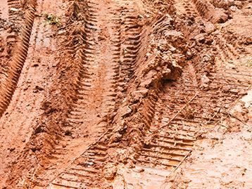 Equipment tread tracks in dirt