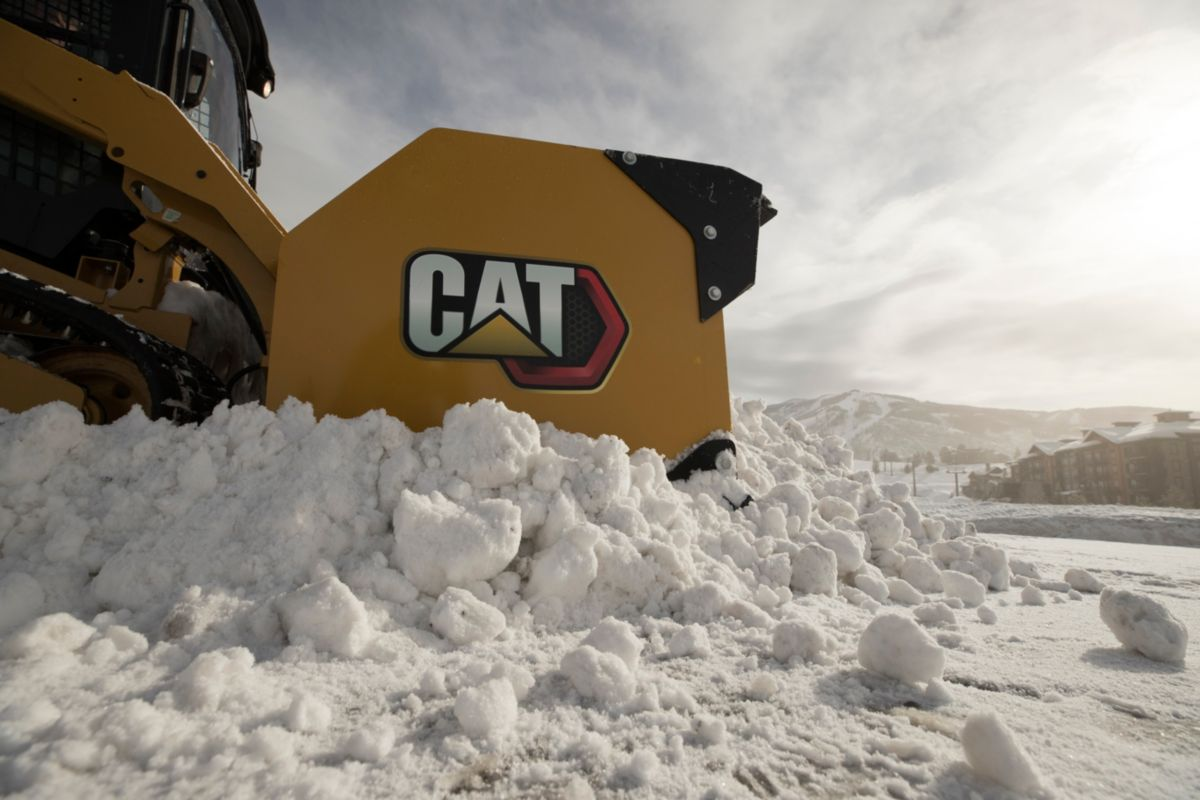 Cat® Snow Push doing the work.>