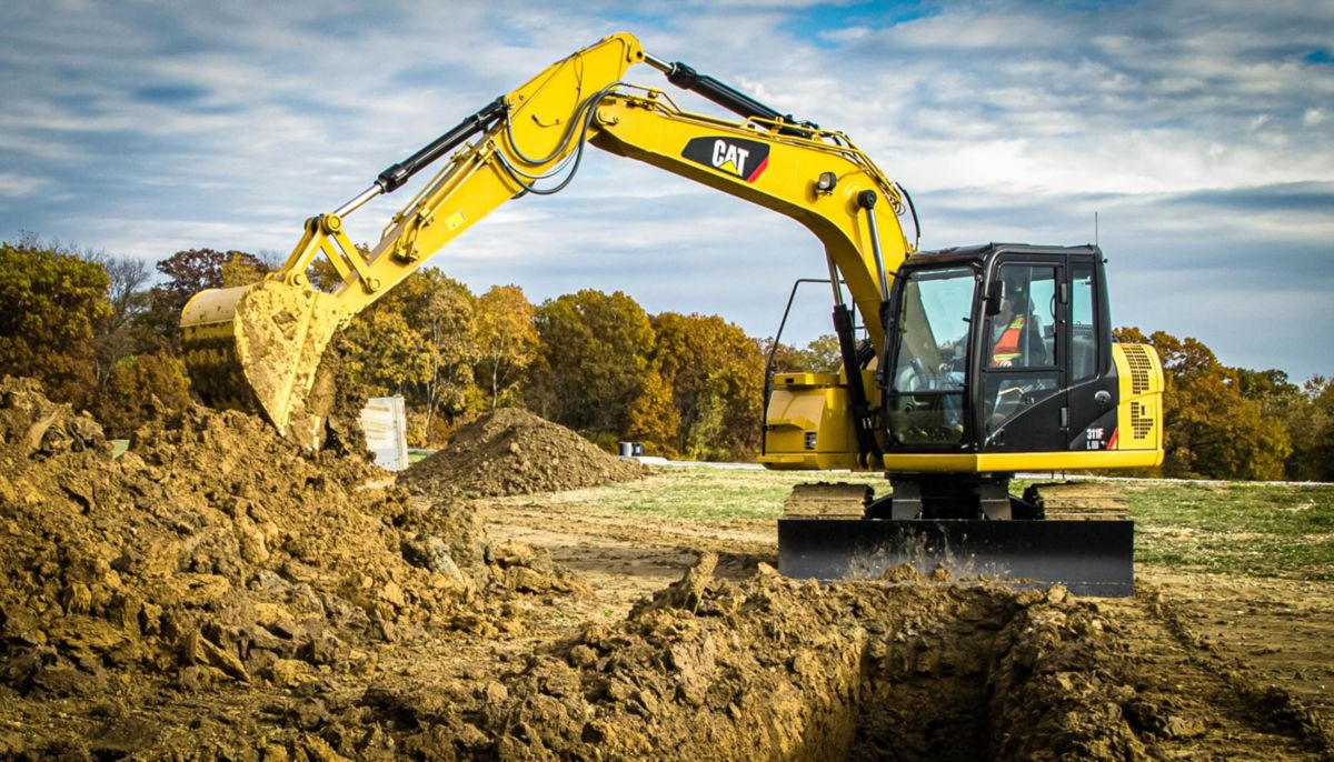 311F RR digging in trenching application with a General Duty Bucket>