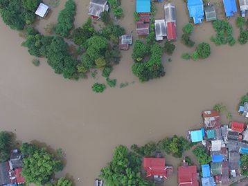 Natural Disasters - Aerial view of flooding in residential area