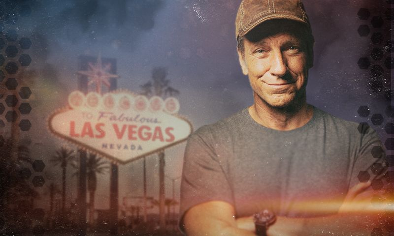 Mike Rowe in front of Welcome to Vegas Sign